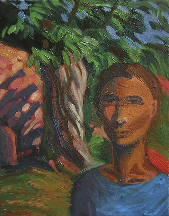 Portrait de garçon dans un jardin