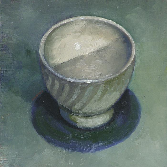 bol blanc en céramique sur fond vert