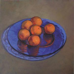 plat bleu transparent et oranges still lives
