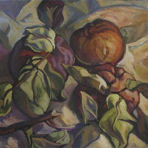 pommes mûres et feuilles sur drapé