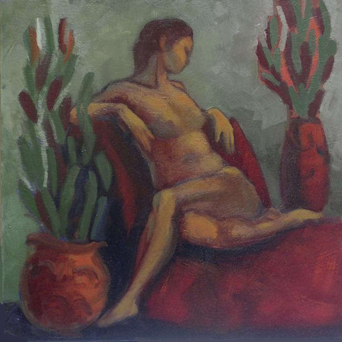 nu féminin assis sur un fauteuil rouge