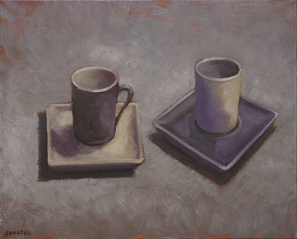 deux tasses à café blanc et gris sombre